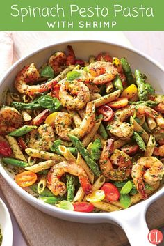 Pesto is a great big-batch sauce for using up a mix of herbs and greens, but it tends to go army-green if made ahead.  A simple shrimp and asparagus pasta toss lets the pesto shine; you could also use chicken breast, broccoli florets, or haricots verts. | Cooking Light