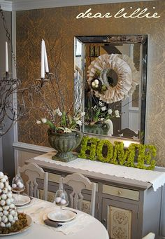 This dining room, is so lovely.  I really love the wreath on the mirror.