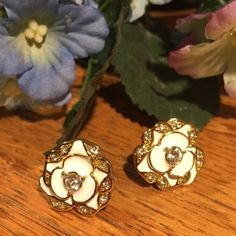 """kate spade earrings. Price Firm. Pretty petals adorn these adorable kate spade earrings. Featuring sparkling crystals enhanced by a color enamel background, these gold plated earrings are floral, flirty and just plain fun! Gold plated metal. Approx diameter: 1/2"""". New without tags. kate spade Jewelry Earrings"""