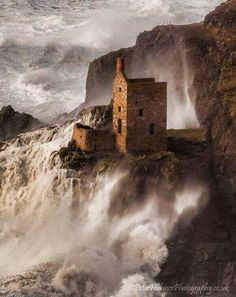 Beautiful photograph of Bottallack engine house amidst stormy seas and crashing waves. Cornwall.  Photo by Peter Hulance Photography.