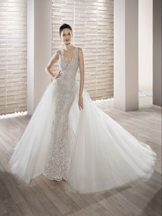 9abcfaabff17 Demetrios Wedding Dress - Style 707 : This stunning lace adorned sleeveless  v-neck sheath gown with sweep train and striking low sheer back with lace  and ...