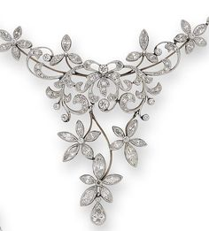 A diamond garland necklace  The front designed as a scrolling cascade of stylised floral and foliate motifs, on a backchain composed of articulated navette-shaped knifewire links, each overlaid with a single-cut diamond trefoil, set throughout with marquise, old brilliant and single-cut diamonds and a single pear-shaped diamond drop, principal diamonds approximately 5.30 carats total, length 43.5cm. Edwardian or Edwardian style.