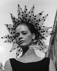 Celia Hammond models a spotted, tulle, headdress by Yves Saint Laurent at a show of Simone Mirman's autumn collection. September 1964.