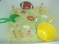 Football themed sensory bin-- just need to make this *not* a Packers bin.