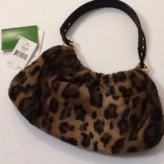 """Kate Spade Medium Mariana Leopard purse Kate Spade """"Medium Marina'. Made of faux fur in a leopard print, with a sturdy leather handle with snakeskin texture. Gold tone hardware. The closure is magnetic. Interior lined with a bright green satin, and includes a zippered compartment. Item number is AH5108904D, basel/leopard. Retail $245. This items does NOT  have signs of use, but tags have been removed. Measurements:  13"""" width at widest point, 7""""  height. 1"""" depth Inside features: zippered…"""