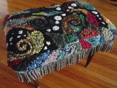 First project I made from a bag of rug hooking scraps someone gave me.