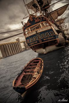 """18th Century Swedish East-India trader """"Götheborg"""" and his boat."""