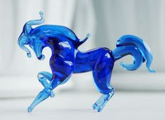 A ton of colorful glass animals, and I'd have Laura's favorite figurine in her favorite color.