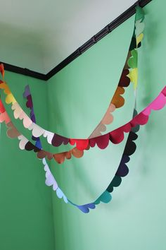 I want to try and make these!   prismatic clouds felt garland. via Etsy.