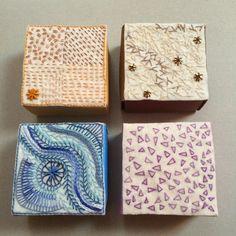 4 små askar i matchande papper till broderiet http://textilslojdslarare.blogspot.com