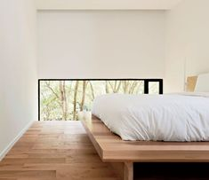 This bedroom is defined by low windows.