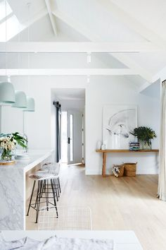 White marble + seafoam pendants in the kitchen/entrance