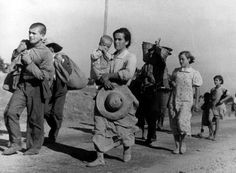Magnum Photos - Robert Capa © International Center of Photography View profile SPAIN. Andalucia. Cerro Muriano, Cordoba front. Civilians fleeing. September 5th, 1936.