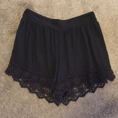 Black Flowy Shorts lace bottom Flowy shorts! super cute! very comfortable and in great condition! Urban Outfitters Dresses