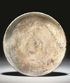A BYZANTINE GLAZED SGRAFFITO POTTERY BOWL   CIRCA 12TH CENTURY A.D.