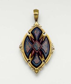 AN ANTIQUE AGATE AND GOLD PENDANT -  Designed as an orange banded agate and bloodstone cross within a sculpted gold lozenge-shaped panel, mid-19th century