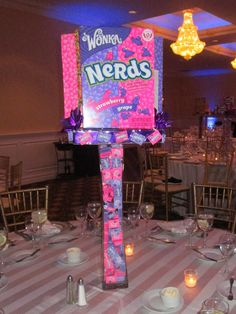 This awesome centerpiece was the Nerds table for this candy theme bat mitzvah. Riser was also filled with boxes of Nerds. Candy Theme Centerpieces, Bar Mitzvah Centerpieces, Bar Mitzvah Themes, Bar Mitzvah Party, Bat Mitzvah, Candy Themed Party, Candy Land Theme, Nerd Party, Nerds Candy