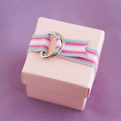 """DIY Wedding Favor Box Ideas! Favors are an easy, elegant way to say, """"Thank you!"""" to guests, no matter the occasion. From weddings to birthday parties to corporate extravaganzas, these beautiful and functional favor boxes can be used both as fun favors and as part of the décor. With many colors, patterns, and textures available, these customizable boxes and can be tailored to suit any theme or event. #wedding #weddingfavors #weddings #weddingplanning #favors #parties #partyideas #ad"""