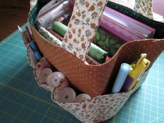 """If you belong to a sewing or quilt guild, a modern-day """"sewing bee"""", or like to sew while you travel, this bag wasdesigned to holdall those little goodies you need to bring. This practical bag pa..."""