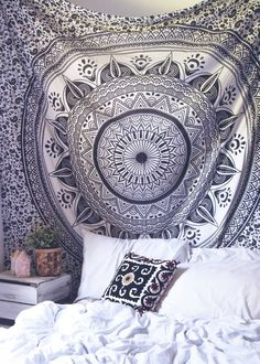 Top off your bed or accent a wall with this unique boho tapestry, featuring a bold black and white mandala pattern on soft white fabric. This tapestry also doubles as a picnic blanket, perfect for fes