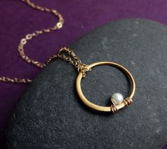 So simple = elegant. {who doesn't have a lone loop earring around that could become THIS? Too easy to DIY!}
