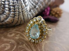 New addition to our shop! Use code SAGEINSPIRATIONS10 for a 10% discount at checkout. Blue Topaz & CZ Sterling Silver and Brass Ring - Size 6.75 - $105.00