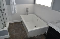 White stand alone soaking tub by Brytons Home Improvement Cheap Bathroom Remodel, Bathtub Remodel, Shower Remodel, Bathroom Remodeling, New Home Windows, House Windows, Small Toilet, Bath Or Shower, Bathroom Photos
