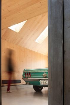 The studio built the garage with a prefabricated design using cross-laminated timber (CLT) because it wanted to learn how to use the engineered-wood building material. Compact House, Micro House, Timber Architecture, Architecture Details, Building A Garage, Vintage Mustang, Studio Build, Architectural Materials, Cedar Siding