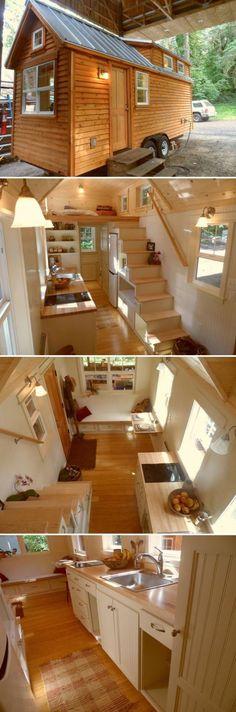 Casa construída com carroceria com escada usada como porta coisa
