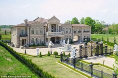 Is it the Palace of Versailles or one Canadian couple's $17.8m copy? Mansion built by husband and wife for 18th century-themed wedding... and sold just three months later