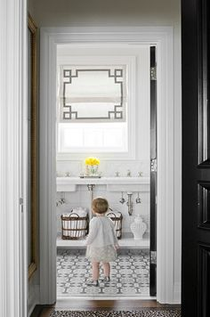 So much to love...the gorgeous roman shade and floors, the classic fixtures and that sweet baby.