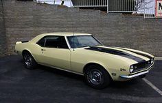 1968 Chevrolet Camaro Z/28. This butternut yellow with black racing stripes is a great muscle car that would be amazing as a resto mod!