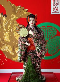 Life-sized doll's kimono is made from blossoming chrysanthemums, Japan
