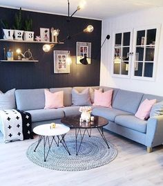 Living room in greys, black and white with a splash of pink
