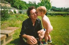 Joe Strummer. Such a nice pic of Joe. Getting a kiss from Lola (or Jazz).