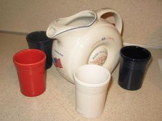 Hall donut pitcher with Fiesta tumblers