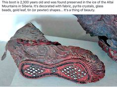 The frozen ground of the Altai Mountains preserved this beautifully detailed Scythian woman's boot for over years. The leather boot was decorated with textile,tin (or pewter), pyrite crystals, gold foil and glass beads. Eurasian Steppe, Altai Mountains, Hermitage Museum, Iron Age, Ancient Artifacts, Historical Artifacts, Ancient Civilizations, Logo Nasa, Leather Booties