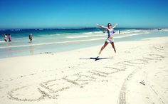 Jumping for joy on the beach at Geraldton, Western Australia