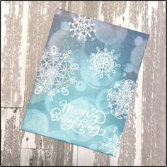 Today I'm showing my card creation using some Distress Oxide inks and a watercolor bokeh technique along with some embossed Simon Says Stamp snowflakes.