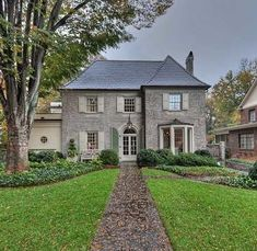 love this house! love the traditional landscaping too!