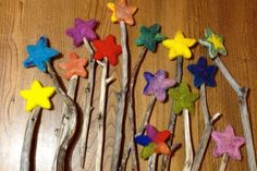 magic wand made of a natural branch or a straight wood stick and a felted star -make with preschool!