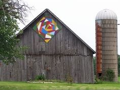 crazy quilt 'barn quilt'- barn quilts are quilt-inspired paintings on wood, hung on barns, obviously. the examples in this article were all part of the 'door county barn quilts project'. *barn pictured is part of the Lasee Farm, Sturgeon Bay Iowa, Wisconsin, Michigan, Minnesota, Barn Pictures, Amazing Pictures, Painted Barn Quilts, Old Barns, Country Barns