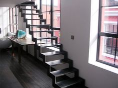 """Simple and airy with sides so """"pixelated"""" black metal staircase that seems to float between the floor and the mezzanine loft occupied. - See more at: http://loftylovin.tumblr.com/loftstairideas#sthash.eso5aODM.dpuf"""
