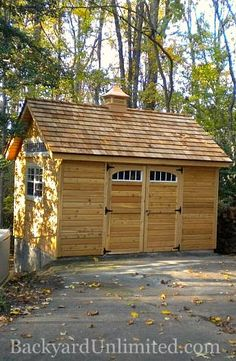 10'x12' Garden Shed with Cedar Siding, Custom Windows, Cedar Shake Roof, and Cupola http://www.backyardunlimited.com/sheds.php