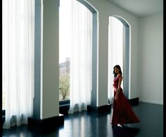In an empty room with big windows and hardwood floors and a long, flowy red dress for dancing.  [from 15 Union Square West]