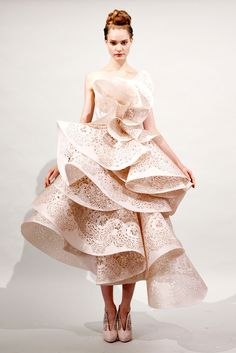3d dress that has good BALANCE of the paper and the curves created. The PATTERN is very interesting because it makes your eye move around following each curve of the dress