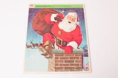 Vintage tray puzzle with a beautiful, vibrant illustration of Santa Claus in a chimney with his bag of toys for the girls and boys!