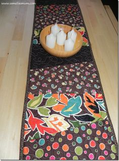 Stack and whack table runner. Great way to practice free motion quilting too!!