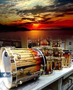 Probably a photoshopped composition, but very nice art of a real set of drumkit pieces including huge bass drum, with red and yellow - brown paint coloring to match the sunset colors beyond the still waters.DdO:) MOST POPULAR RE-PINS - http://www.pinterest.com/DianaDeeOsborne/drums-drumming-joy/ = DRUMS & DRUMMING JOY.  I very much like this peaceful musical instruments pin via Alex Colletti that also fits my SKY LIGHTS Board.