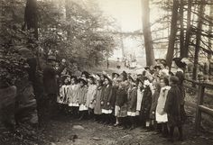 Robert S. Williams, an early administrator at The New York Botanical Garden, instructs schoolchildren on mosses and ferns in the Garden's Forest. We're unsure about the exact date of this photograph but it was taken circa 1911. The children—almost all of them, anyway—seem interested in their lesson.    From The New York Botanical Garden's archival photographs, in the collections of The LuEsther T. Mertz Library.